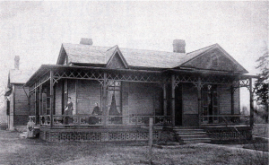 A historic photo of the Love House and Hutchins Forum.